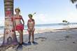 Caucasian girls on beach in snorkel gear