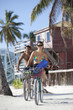 Couple riding bicycles on vacation