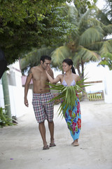 Couple walking in tropical area