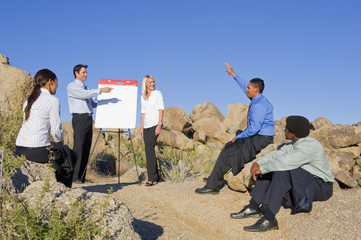Business people having a meeting in the desert