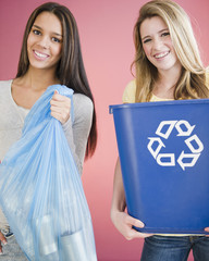 Teenage girls carrying recycling