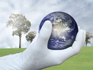 Hand save the world concept(http://visibleearth.nasa.gov)