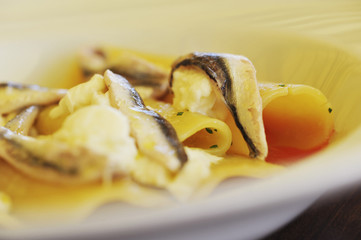 Close up of fish and pasta dish