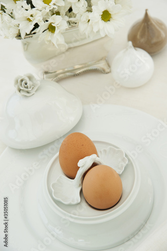 Two boiled eggs in an ornate egg cup