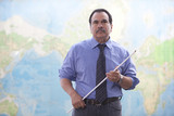 Hispanic businessman standing near map with pointer