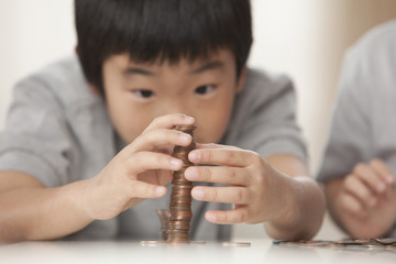 Korean brothers stacking coins