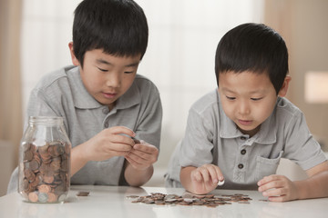 Korean brothers counting coins