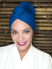 """Glamorous, smiling woman in blue turban"""