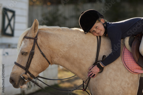 Caucasian girl riding on horse