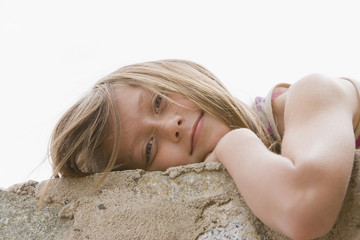 Chilean girl laying on wall