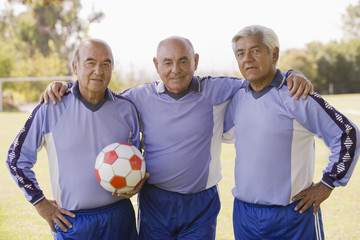 Senior Chilean soccer players standing together