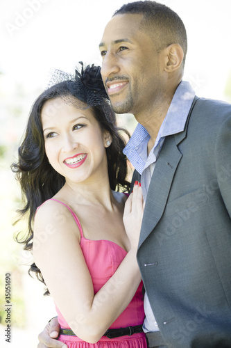 Glamorous couple standing together outdoors