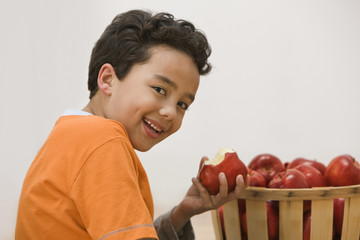 Hispanic boy eating apple