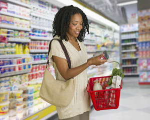 Mixed race woman grocery shopping