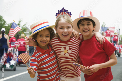 Friends hugging at fourth of July celebration