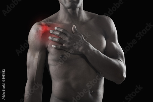 African American athlete with glowing shoulder
