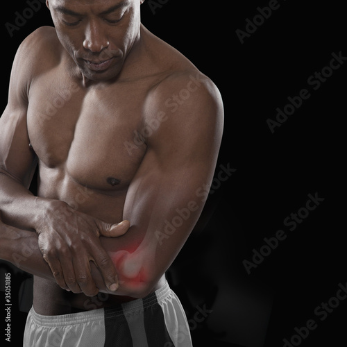 African American athlete with glowing elbow