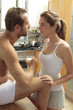 Caucasian couple in pajamas in kitchen