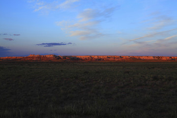 Sunset over field and rock formation
