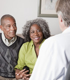 African American couple talking to financial advisor