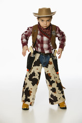 Caucasian boy in cowboy costume