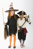 Children standing in witch and pirate costumes