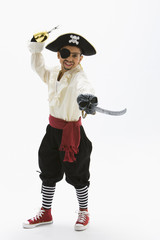 Hispanic boy in pirate costume holding sword