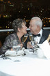 Senior Hispanic couple toasting with Champagne in restaurant