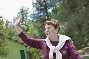Senior Hispanic woman waving