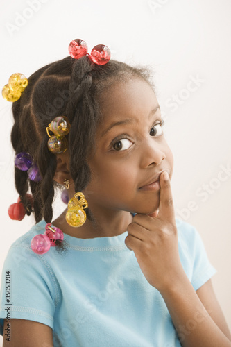 Black girl making shhh gesture