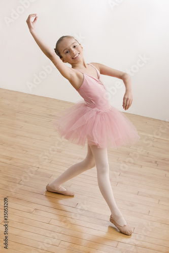 Hispanic girl dancing in ballet tutu