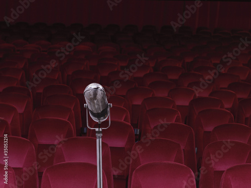 Old-fashioned microphone in empty auditorium