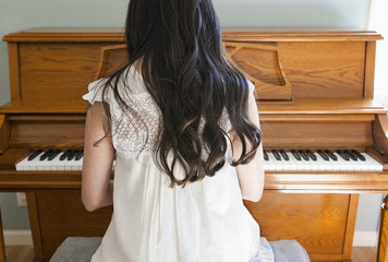 Mixed race woman playing piano