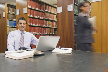 Business people doing research in library