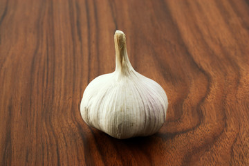 Garlic in wood background
