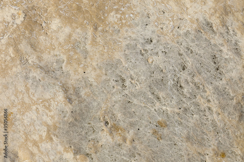 Texture of old yellow stone surface