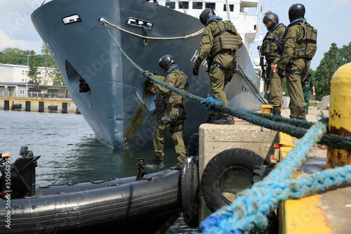 Soldiers marines  boarding a ship in a simulated assault