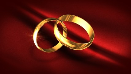 Gold rings against a red fabric