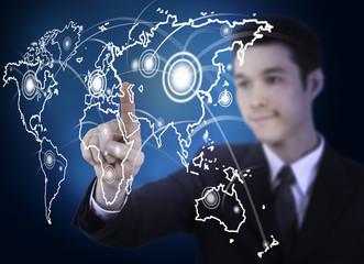 business man pressing a world map touchscreen
