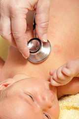 Stethoscope listening to a baby's heart beat
