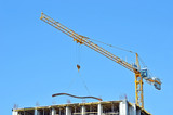 Building crane and reinforcement on construction site poster