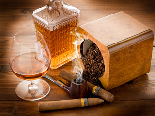 smoking pipe, tobacco, cuban cigar and liquor