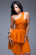 elegant woman in orange dress
