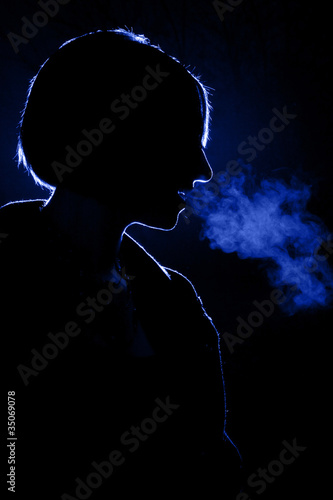 woman exhaling warm breath