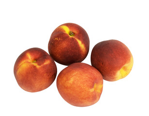 fresh organic nectarines on a white background