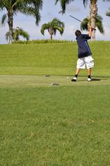 preteen boy golfing