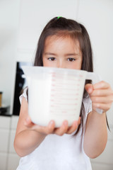 Girl with measuring Cup