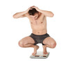 frightened squats on scale young man in panties