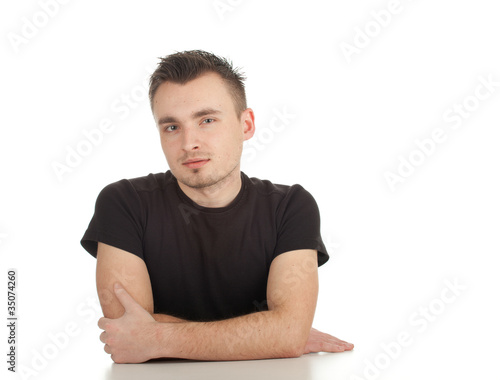 sitting thoughtful young man in black blouse