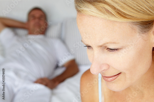 Mid age couple in bedroom